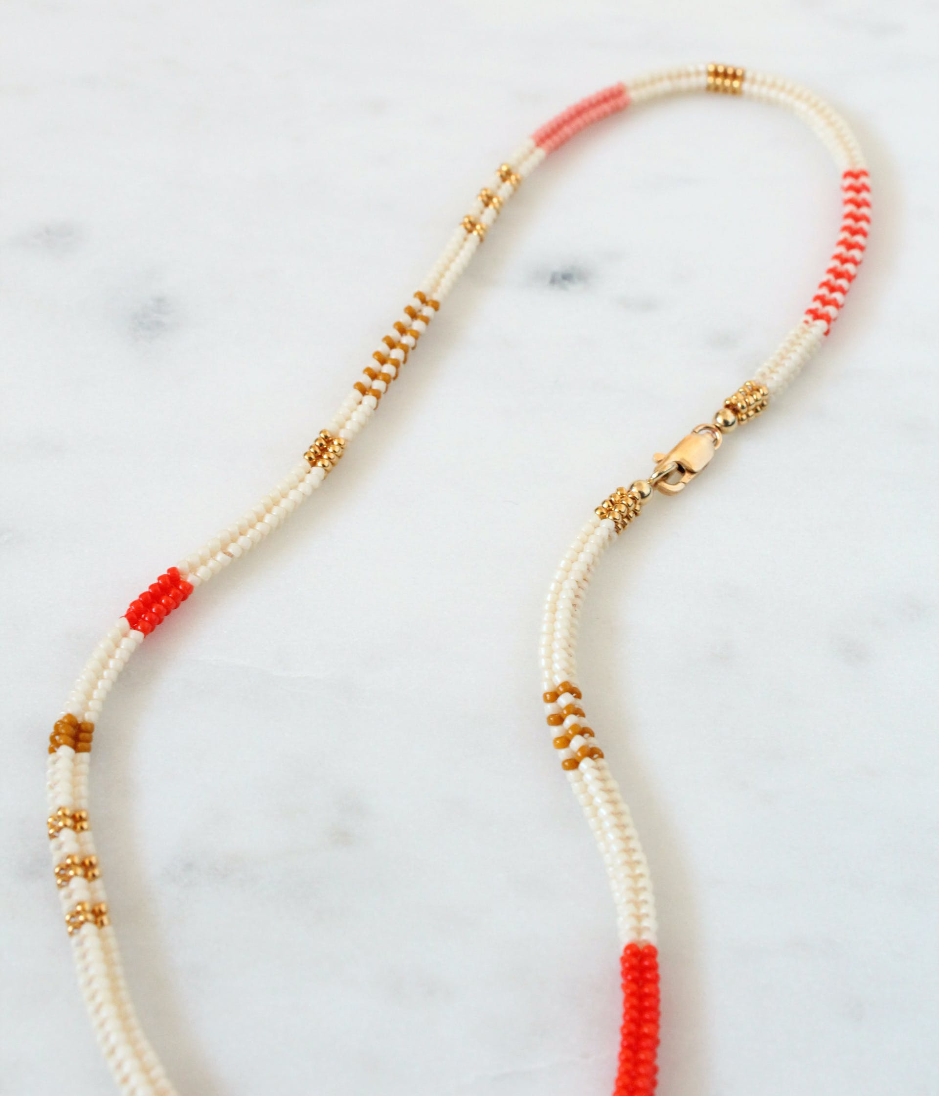 Handcrafted necklace made from tiny glass beads woven together with needle and thread